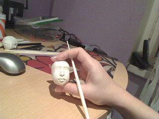Голова модельной куклы из глины